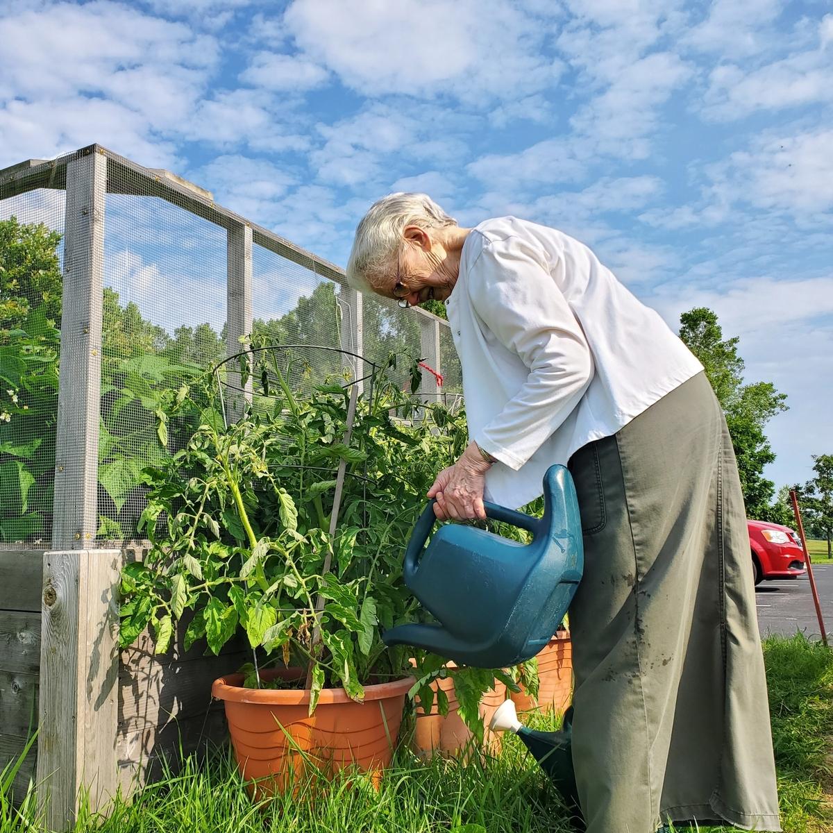 Sister Leanne watering plants
