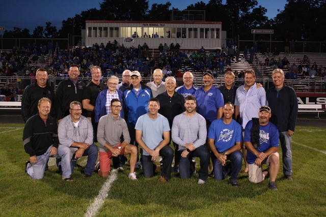 All inductees as well as the Varsity Hockey teams from 1981-1987 who were honored at half time of the varsity football game on Saturday.