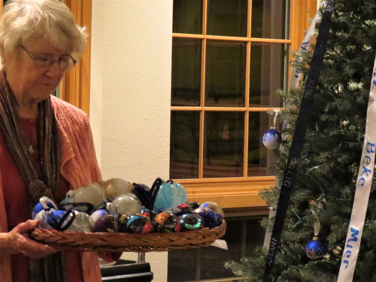 Sister Josephine Goebel, CSA, holds ornaments in preparation for decorating and lighting the Peace Tree in 2017