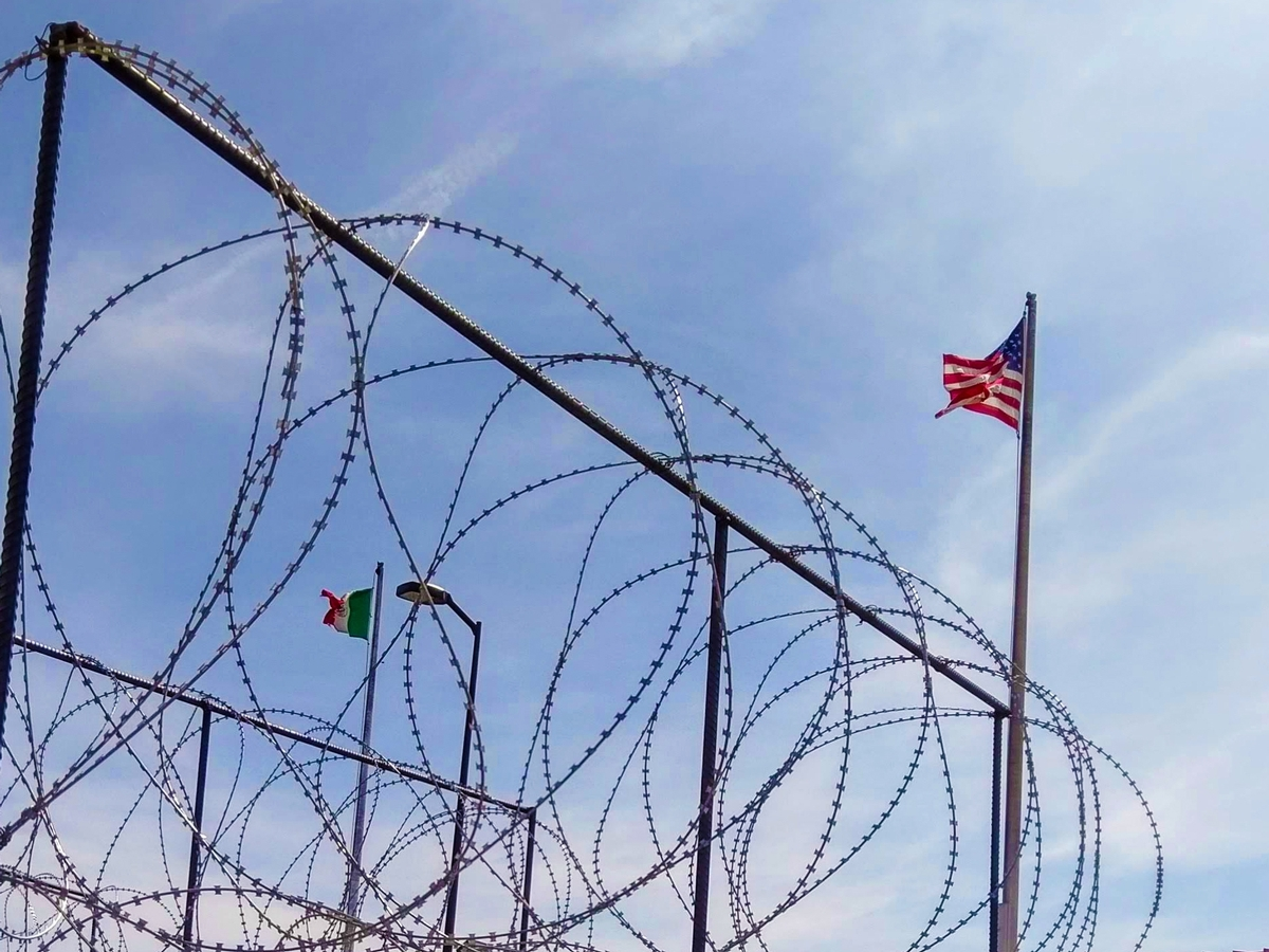 Razor wire and view of gflags
