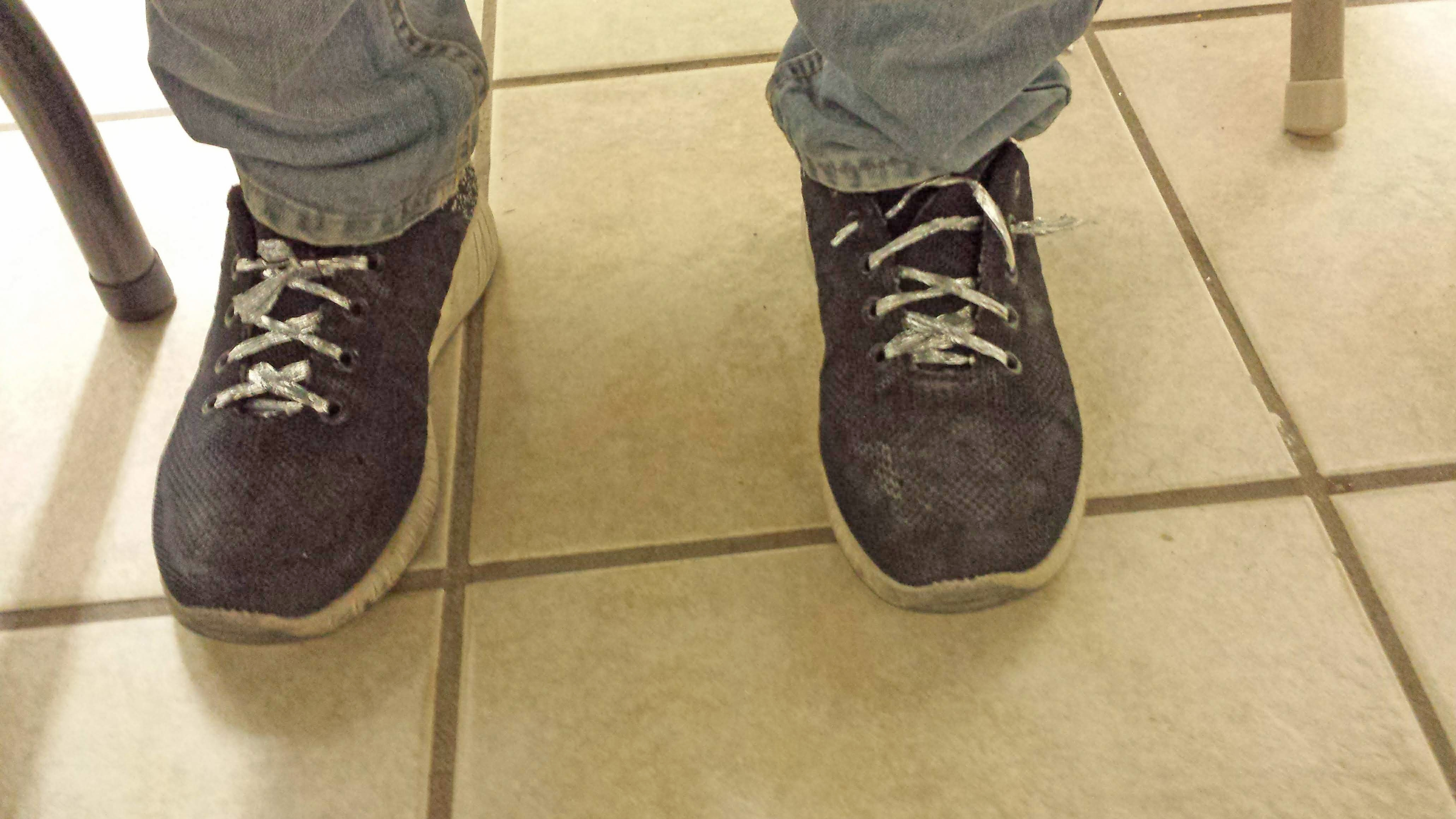 a pair of post detention and pre-new shoelaces