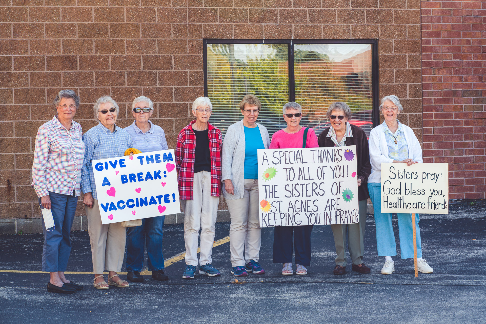 8 sisters with signs