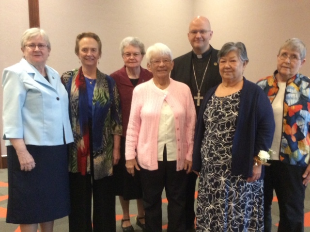 Sisters Susan Kolb, Rhea Emmer, Eileen Mahony, Kathy Cook, Nancy Chow, and Mary Rose Obholz with the Bishop.
