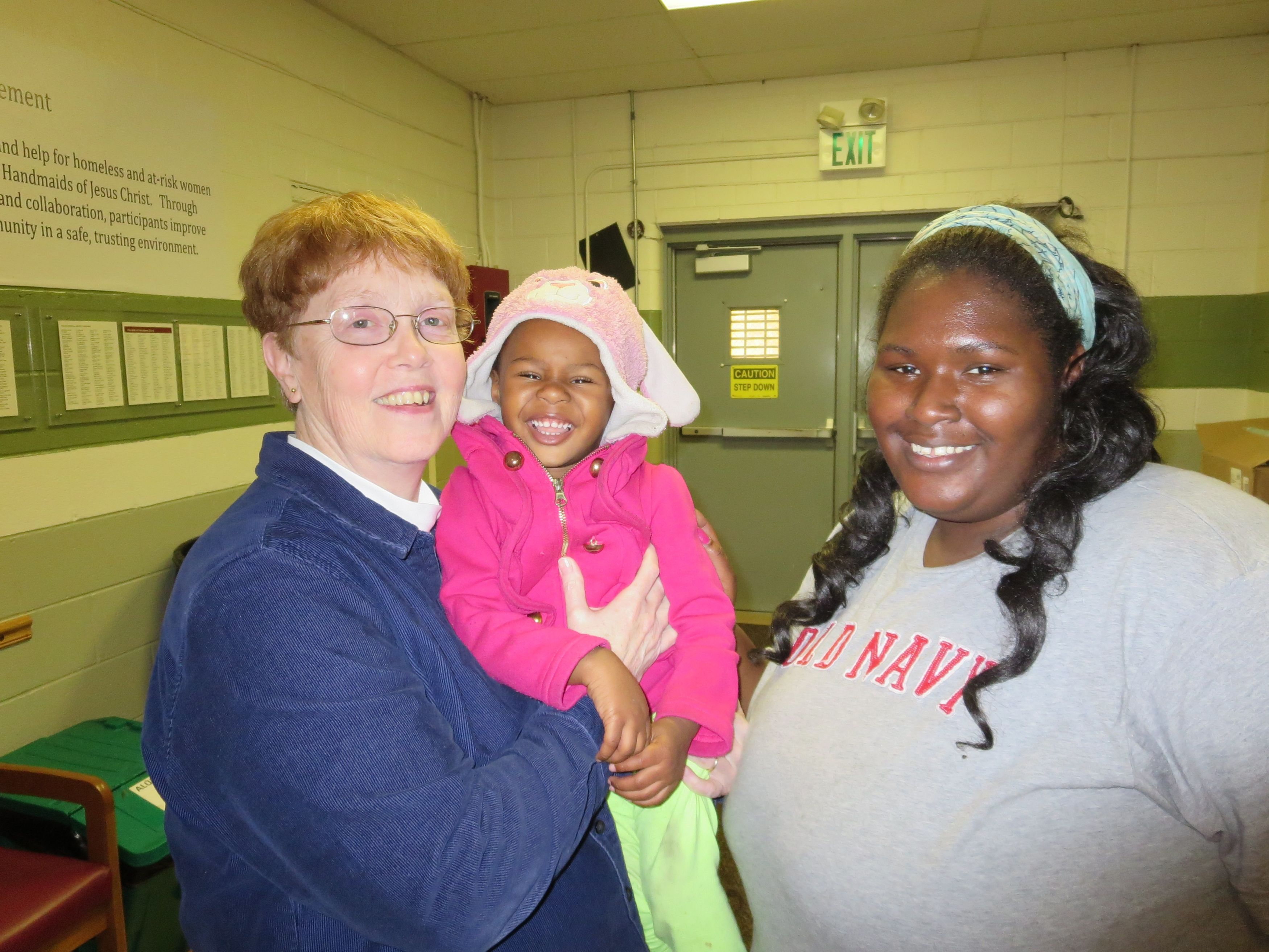 Sister Peg Spindler with clients