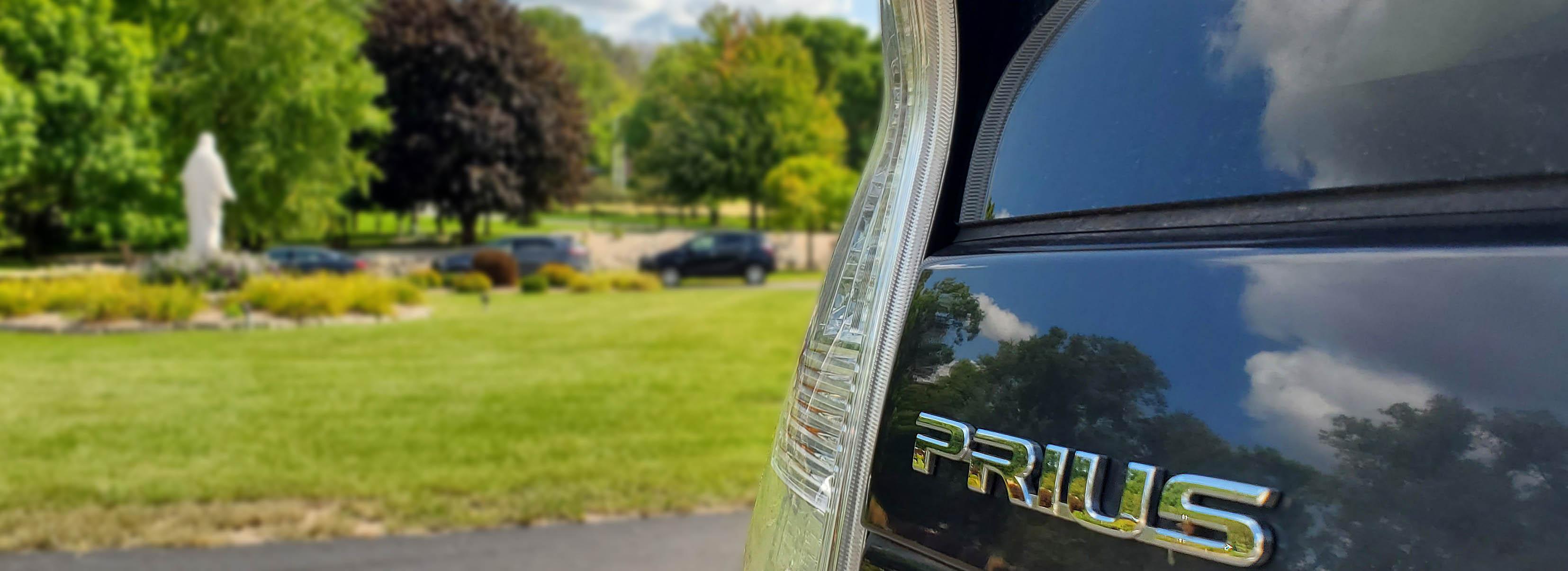 Image of Prius logo in motherhouse parking lot