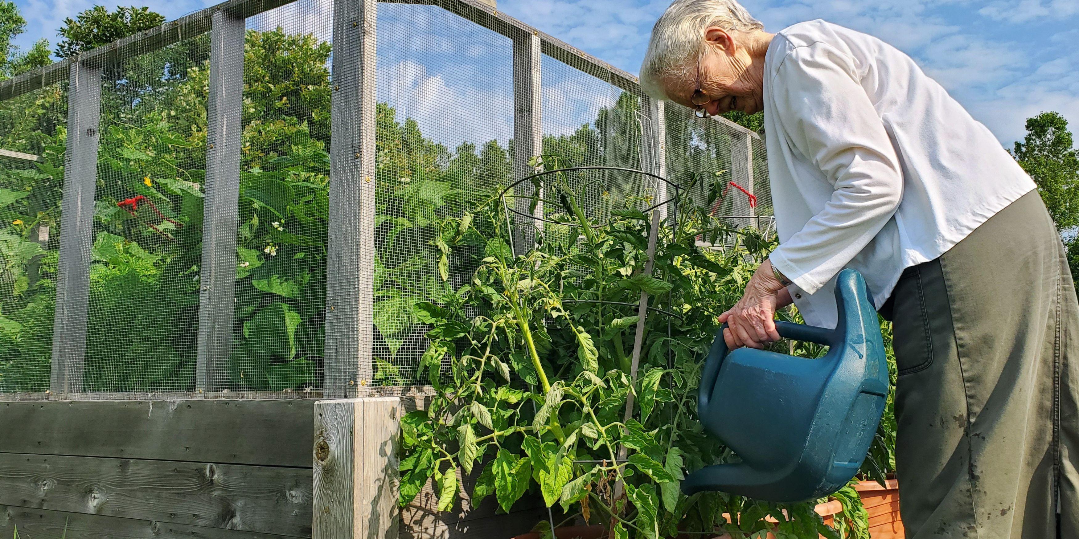 Sister Leanne waters the garden